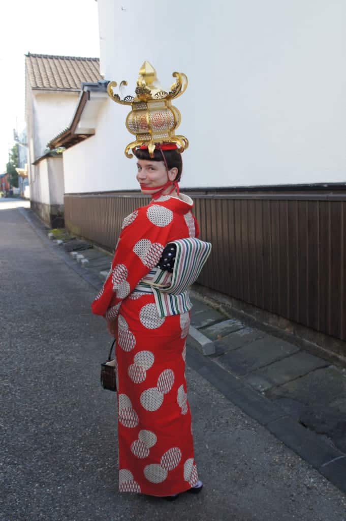 Clémentine wearing antic kimono and lantern in the streets of Yamaga