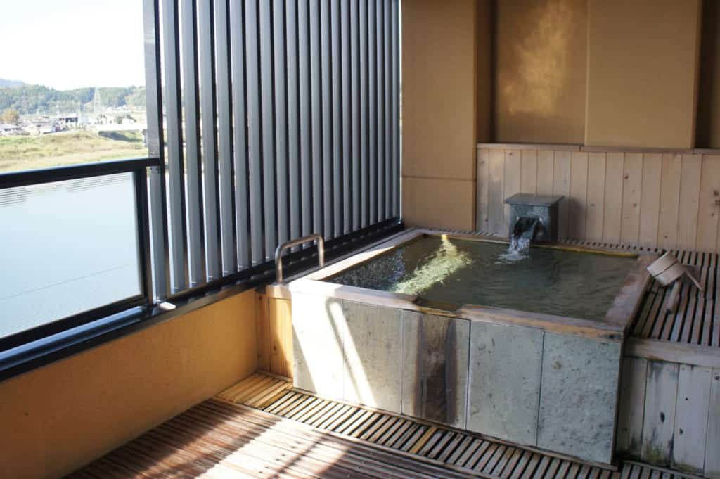 Private onsen on the terrace overlooking the river in Yamaga