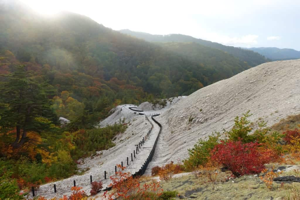 Surprising landscape of all-white jigoku kawarage in the middle of Tohoku's lush nature