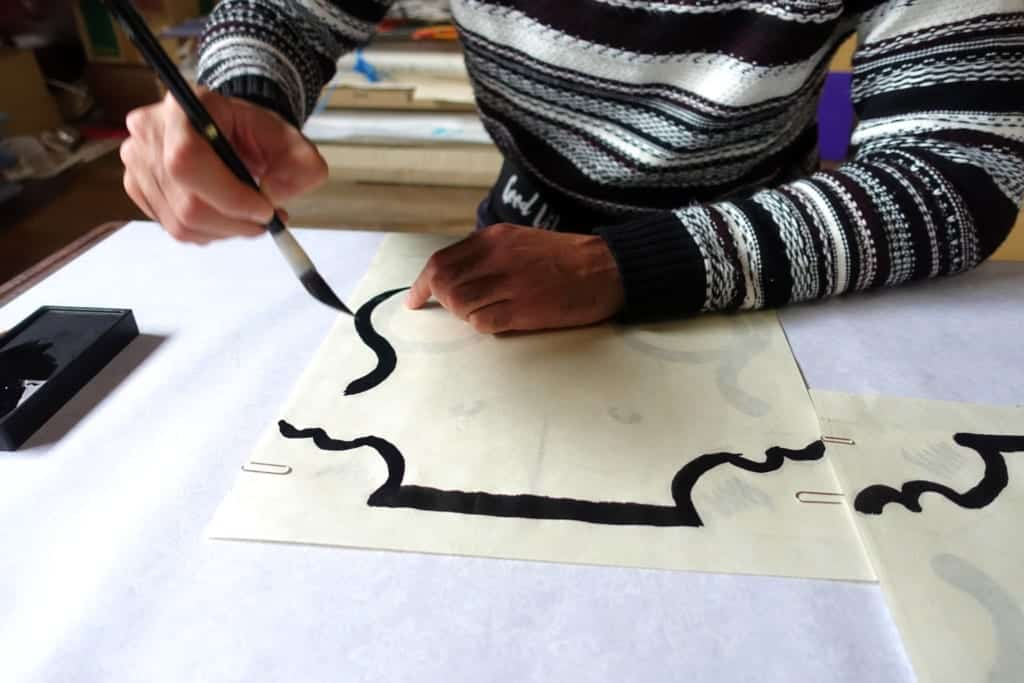 The outlines of the traditional kite patterns drawn in sumi ink
