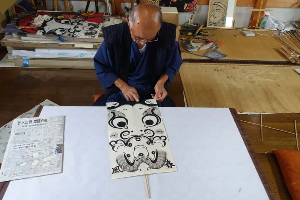 Mr. Ono in the process of making a traditional managu kite