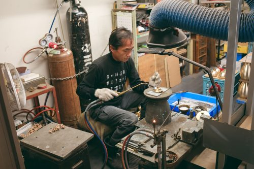 A metal craftsman working at a metal shop in Toyama Prefecture