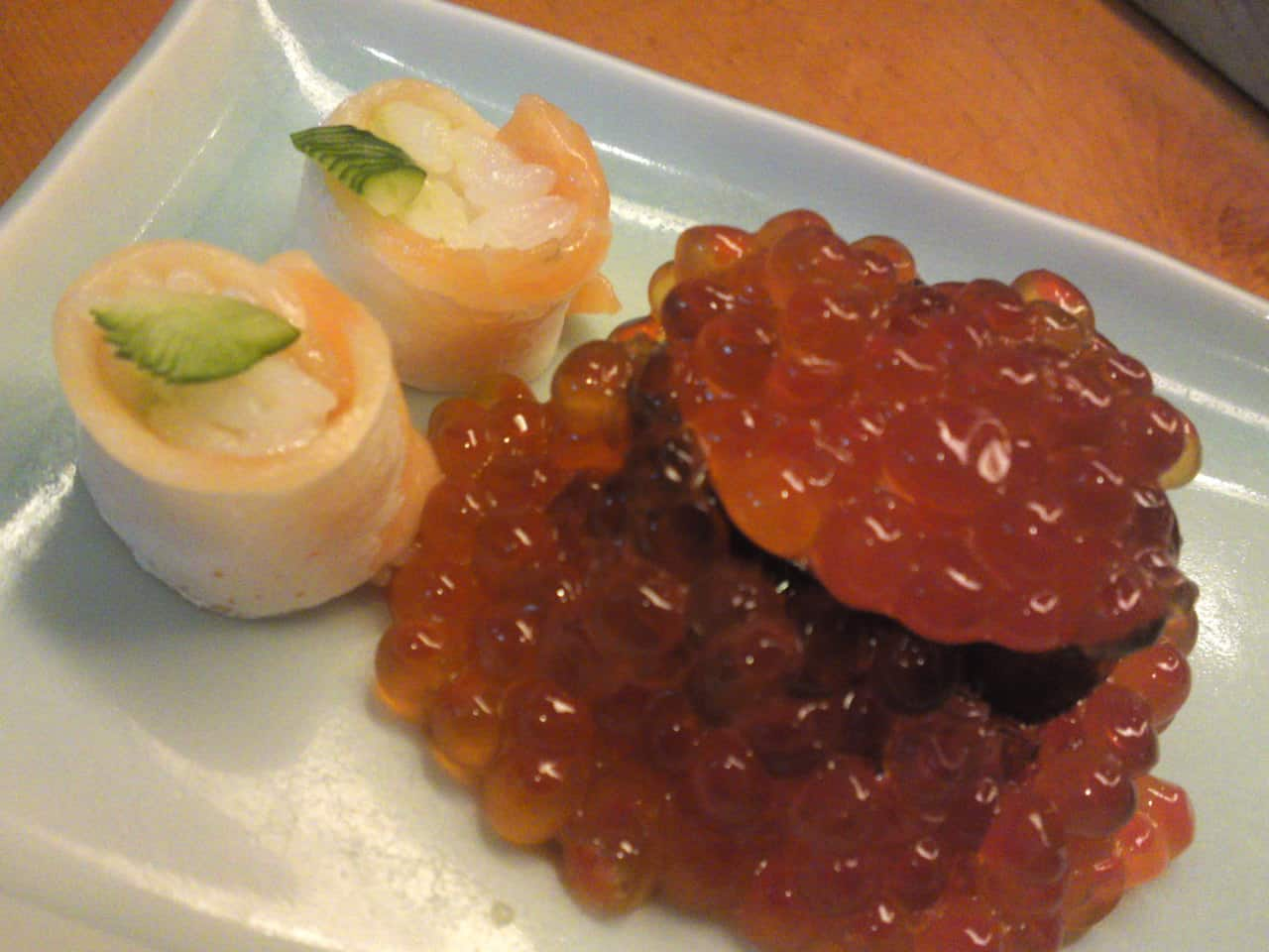 """A rare """"Oyako/Parent and Child"""" rendition of """"Ikura/salmon Roe"""" gunkan with its two """"kids in the form of small gunkan with raw salmon wrapped around minuscule rice balls"""