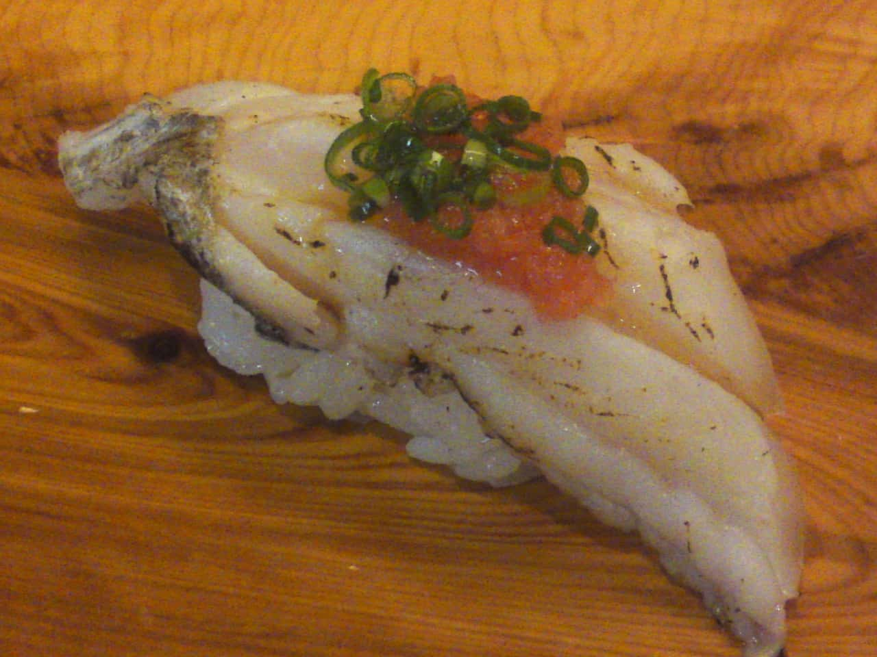 """Tachiuo/Scabbard or Cutlass Fish"" nigiri in ""Aburi/seared"" style topped with ""momiji oroshi/grated daikon seasoned with chili powder and chopped scallion"