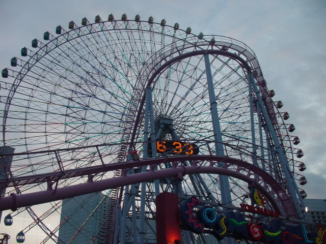 roller coaster and ferris wheel in Yokohama.
