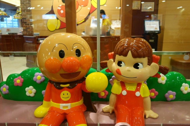 anpanman sitting with the mascot of fujiya cakes