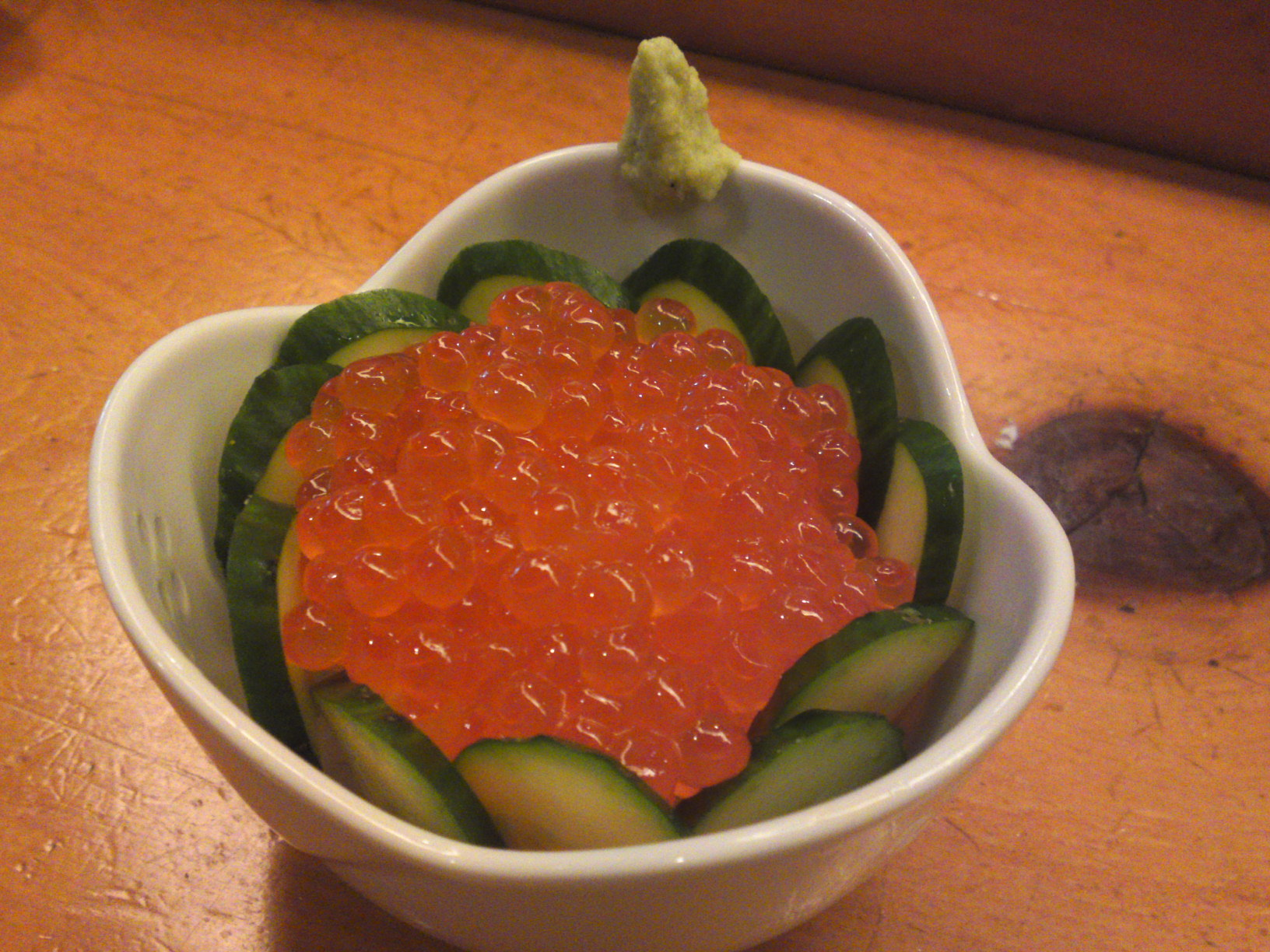"""Ikura/Salmon roe"" ko donburi with sliced cucumber and grated fresh wasabi"