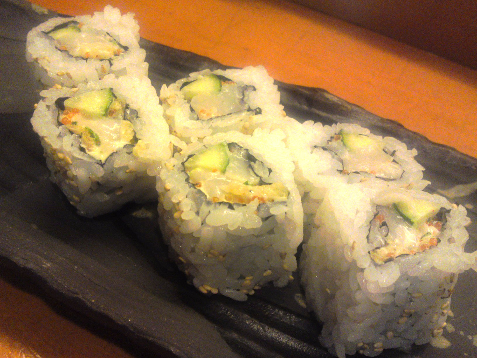 "A ""California roll"" made with spicy raw scallops and cucumber"