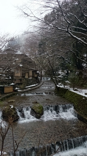 River stream flows through the village of Kifune