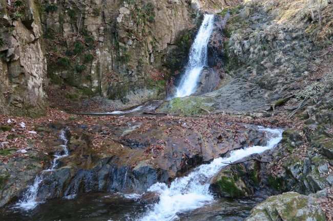 The waterfall at Tyouji Falls, rounded by a hiking path as one waterfall among many around Nikko