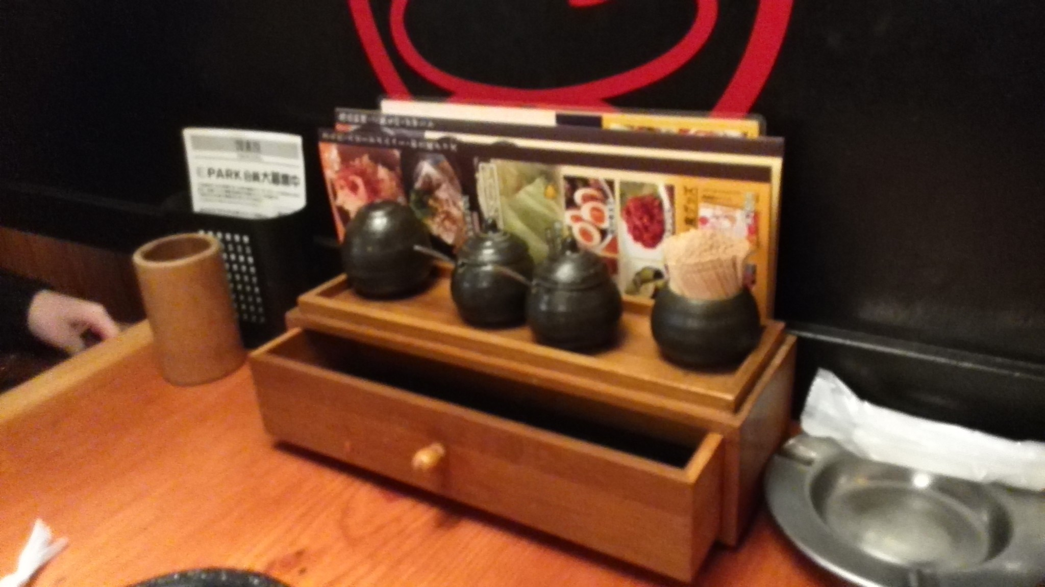 Little drawer at Torikizoku with chopsticks are various spices, a popular Japanese Izakaya restaurant