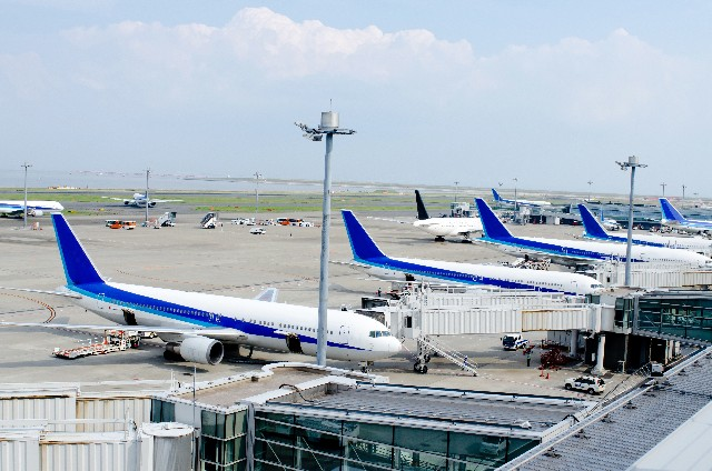 planes are docked at an airport in Tokyo, Japan
