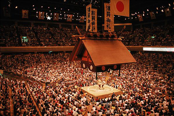huge crowds gather to see the sport of Sumo tournaments in Japan