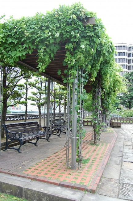 sheltered resting spot with benches in Dejima island, Nagasaki