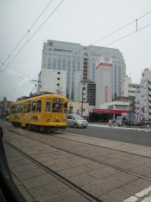 yellow tram that goes around Dejima island, Nagasaki
