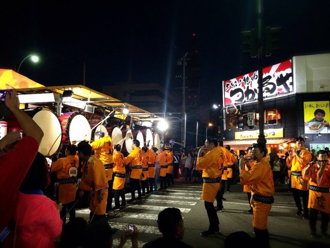 Performers dressed in yellow at the Nebuta Matsuri Festival.