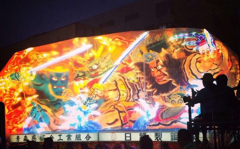 A colorful glowing float at the Nebuta Matsuri Festival.