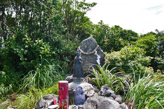 Central peak of Kinpo Mountain where you find a small shrine like area of rocks and a small staute.