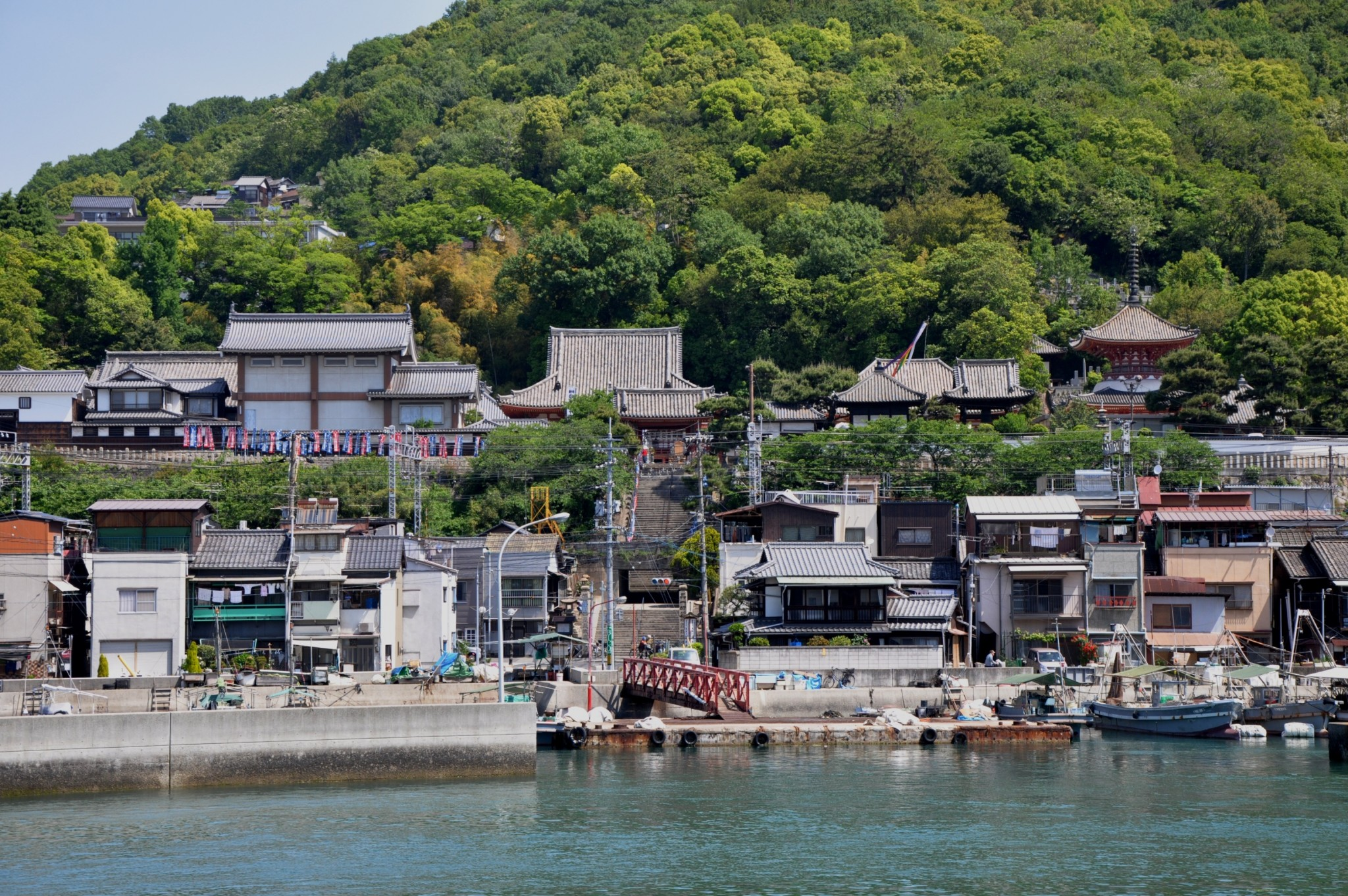 ferry in Onomichi Japan and background of lush greens