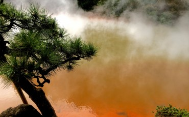 Mist rising from the Beppu onsen, the red gives it the Jigoku hell look.