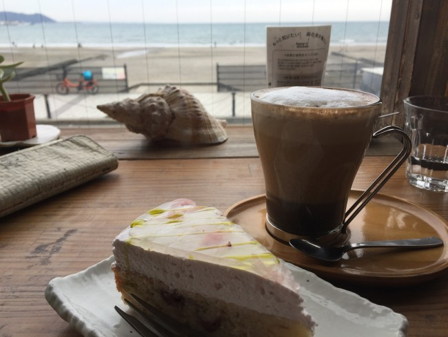 Sakura sponge cake alongside coffee overlooking Kamakura beach, Magokoro cafe also offers vegan dishes