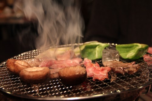 grilling in a yakiniku restaurant