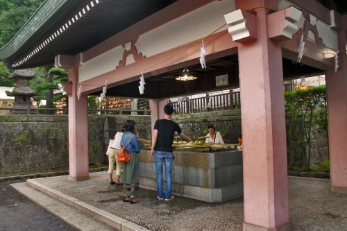Shrine cleaning station at Rokugatsudo festival in Kagoshima.