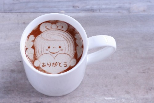 In a cup arigatou, thank you, is written in Japanese