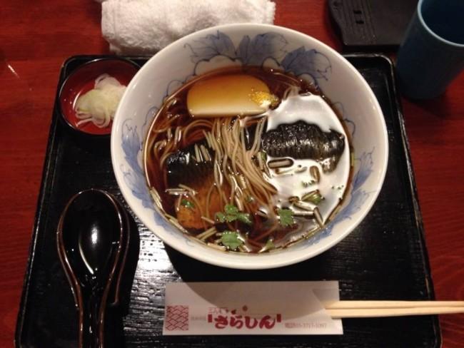 Bowl of soba noodles at a restaurant.