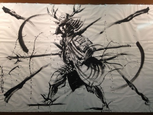 Art dedicated to Osaka Castle that depicts a samurai.