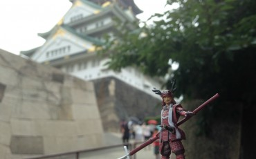 Sanada Yukimura figure in front of Osaka Castle.