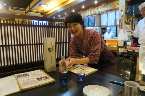 Izakaya staff will serve you tasty Sake made in Niigata!