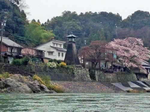 The Kawaminato lighthouse with cherry blossom trees along Nagara river