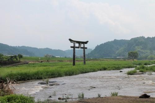 Stone Torii Behind Harajiri Fall in Oita prefecture, Kyushu, Japan.