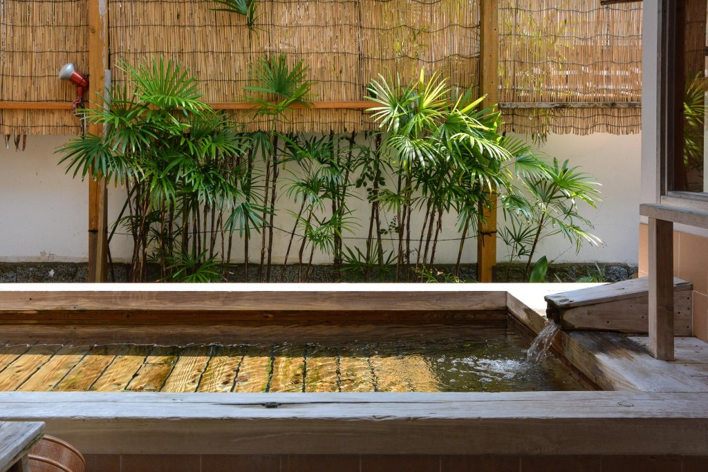 The bath decorated with Japanese cypress, very traditional.