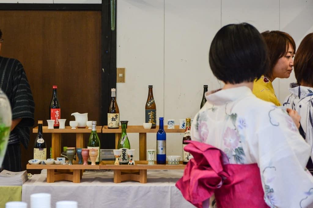 Japanese sake display and women in summer yukata