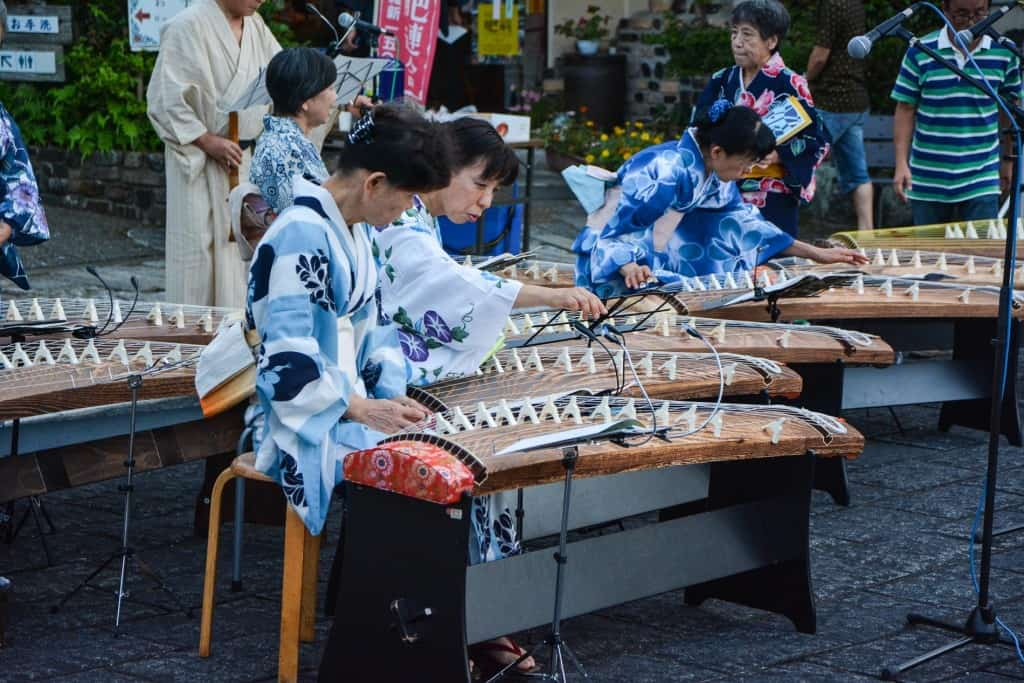 playing traditional Japanese instrument in Japan
