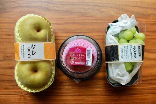 From Left to Right: Pears, a Peach and Grapes