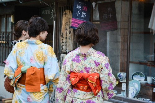 Yukata Girls Admiring the Ceramic Pottery