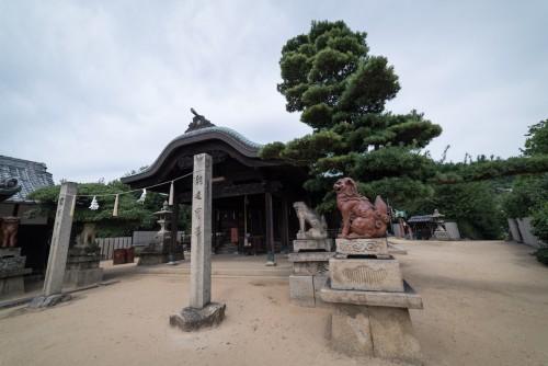 Kurashiki Shimotsui Gion Shrine and the Grand Seto Bridge in Okayama prefecture, Japan.