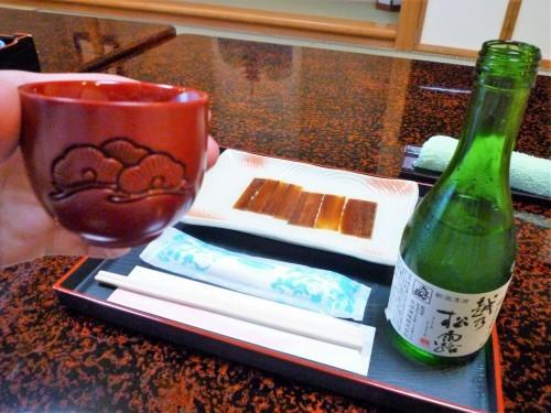 Engraved wooden sake cups at Murakami's Kosugi restaurant.
