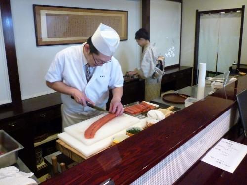 Chef preparing salmon and other food at Shintaku, in Murakami.