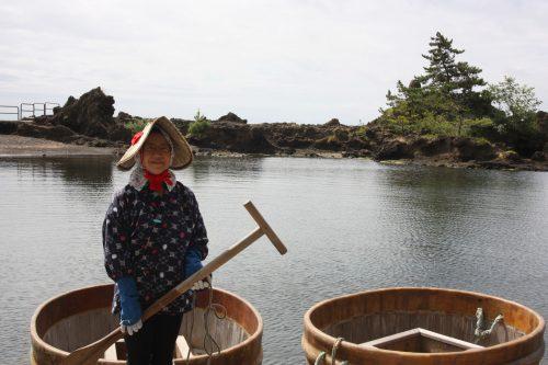 Tarai-bune (tub boat) cruising in Sado Island, Japan.