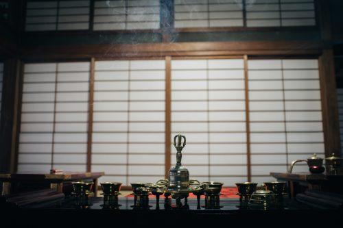 Burning incense at Nisseki Temple, Toyama.