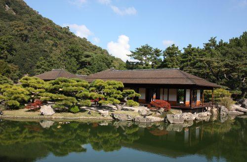 Japanese tea house on a pond in Ritsurin Garden in Takamatsu, Kagawa Prefecture in Eastern Shikoku.