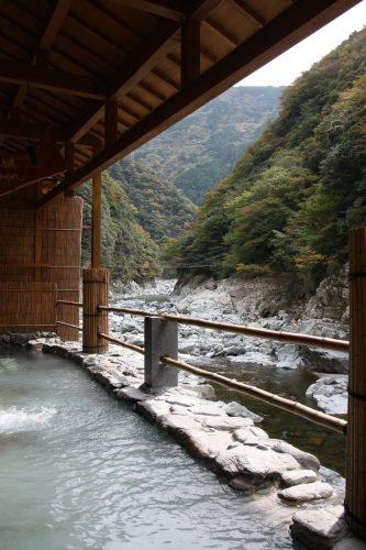 Soak in the hot springs along the river of Iya Valley at Iya Onsen Hotel.