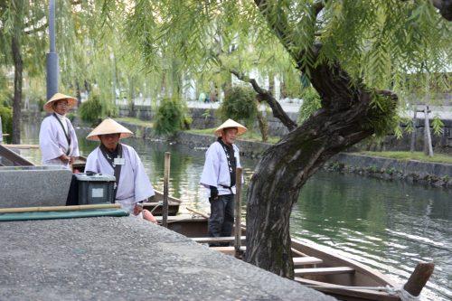 Boatsmen in Bikan historic distict of Kurashiki, Okayama.