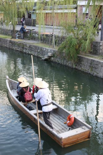 Taking a relaxing boat ride in the Bikan historic distict of Kurashiki, Okayama.