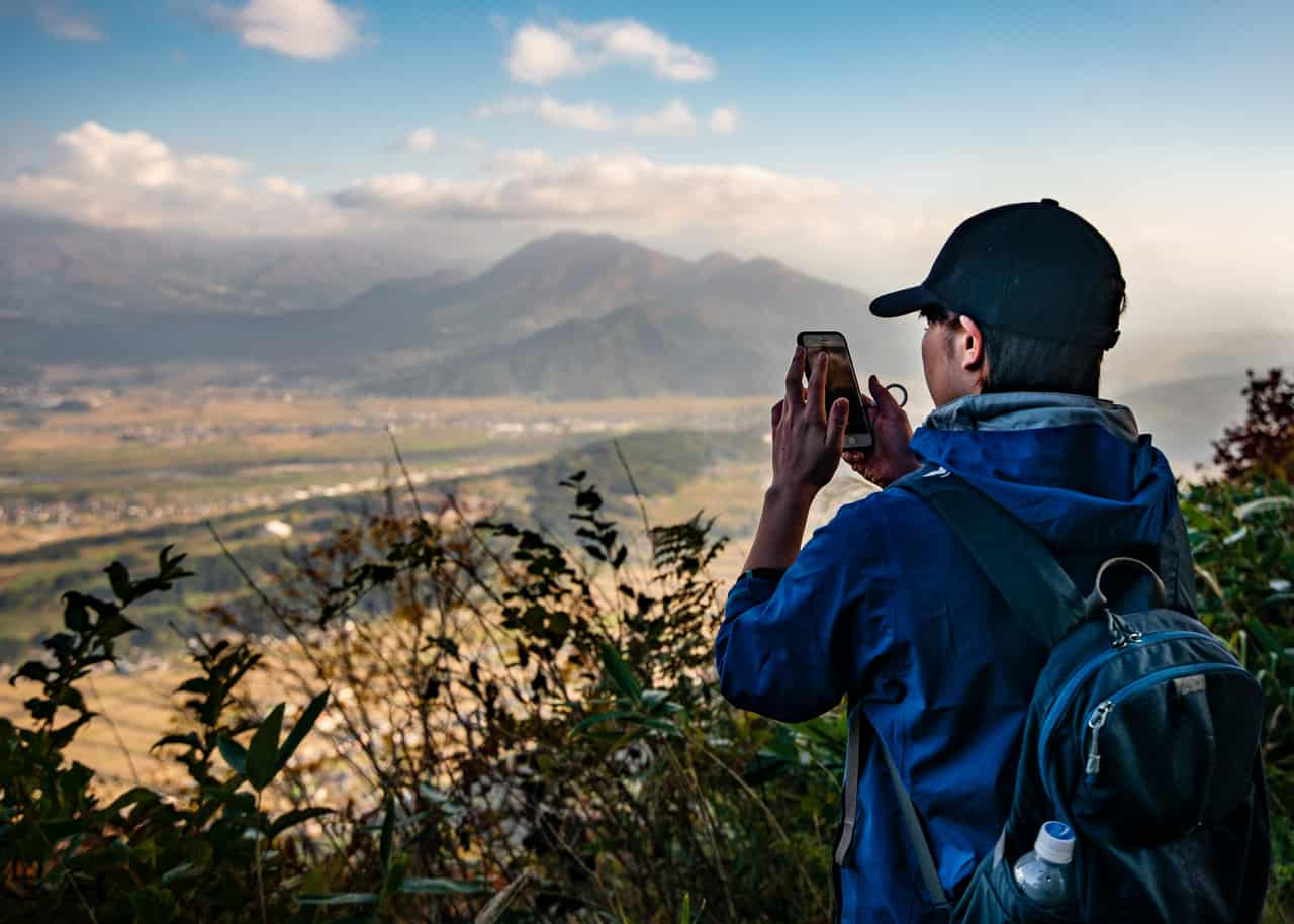 hiker enjoys the view of nagano from the shinetsu trail
