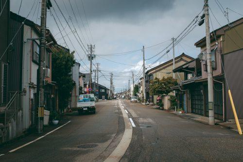Narrow quiet streets of Takaoka city on Toyama Bay.